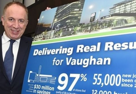 "Vaughan Mayor Maurizio Bevilacqua with a sign saying ""Delivering real results for Vaughan"""