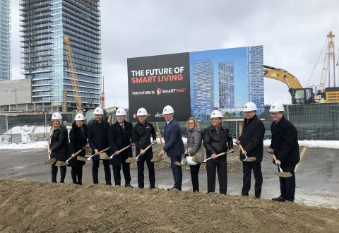 SmartCentres and government leaders hold shovels in front of future purpose-built rental tower site